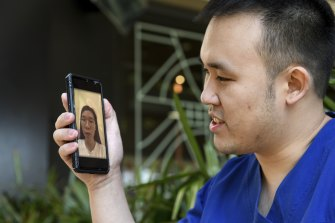 Dr Raymond Chan speaks on Facetime with his Vietnamese fiancee, Thi Dung Nguyen, who has a prospective spouse visa but cannot get a travel exemption.