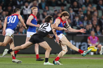 Ben Brown gets a kick away for Melbourne.