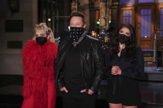 Elon Musk with Miley Cyrus and Cecily Strong during Saturday Night Live promotions earlier in the week.