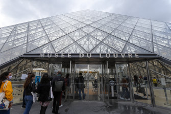Visitors queue outside the Louvre Museum at Louvre, Paris, last week, as France begins to open up after a national lockdown.