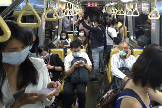 Commuters go about their normal day in Taipei. Taiwan used contact tracing and years of pandemic rehearsals as the main weapons against COVID-19, avoiding the need for restrictions.