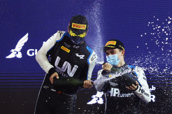 Oscar Piastri celebrates his win in race two of the opening round of the F2 championship with second-placed Guanyu Zhou of China at the Bahrain International Circuit on Saturday.