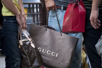 Luxury brands such as Gucci and Cartier have pocketed millions in JobKeeper while hiking their profits.