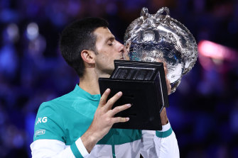 Novak Djokovic holds the Australian Open trophy.