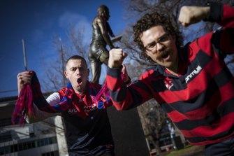 Sam Holloway and Tom Shiels celebrate outside the MCG on Sunday.