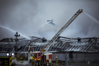 Firefighters battle the blaze at e-waste facility MRI E-Cycle on August 9