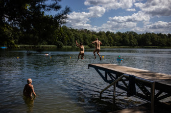 Nudists jump into a lake in Zossen, Germany.