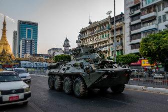 An armoured vehicle moves through Yangon on Sunday.