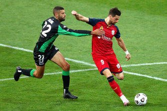 Tomi Juric (right) is keen to make an impact at Adelaide and reclaim a spot in the Socceroos line-up.