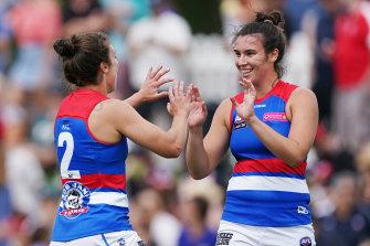 Bonnie Toogood and Ellie Blackburn celebrate a goal.