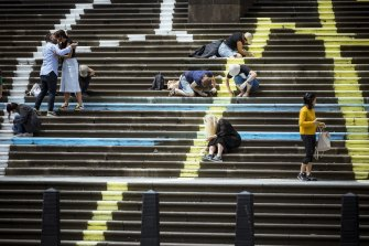 Parliament House becomes a canvas for a work by Kerrie Poliness, together with members of the public.