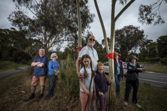 Former VicRoads transport planner John Graves with granddaughters Millicent and Sylvia and members of the Eltham Community Action Group.