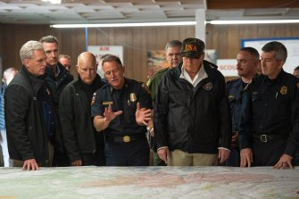 Then Cal Fire Chief Ken Pimlott briefs US politicians, including President Donald Trump, during the California wildfire of 2018.
