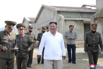 An undated photo provided on Thursday, July 23, 2020 by the North Korean government, in which leader Kim Jong-un visits a new chicken farm.