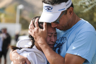 Ella Cabigting is embraced by her father Emerson as they reunite after the shooting at Saugus High School.