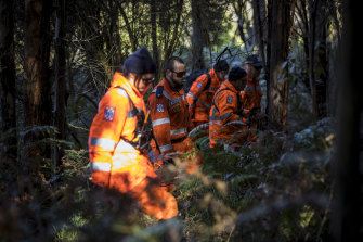 SES volunteers searching thick bushland for William Callaghan on Tuesday.
