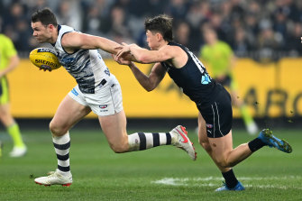 Patrick Dangerfield attempts to get away from the Blues' Sam Walsh.