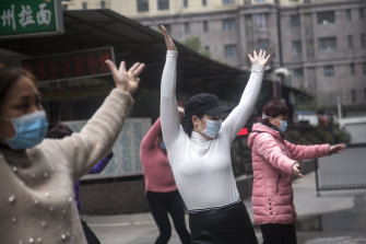An exercise class in Wuhan continues in spite of the march of the deadly virus.