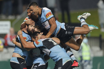 Aaron Woods of the Sharks celebrates a try.