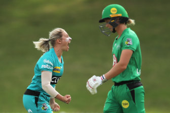 Brisbane's Delissa Kimmince celebrates taking the wicket of the Stars' Meg Lanning.