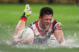 Joseph Manu crosses a very wet try line.