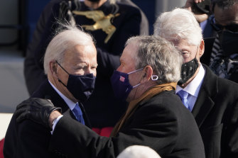 President Joe Biden talks to former presidents George W. Bush and Bill Clinton after the inauguration.