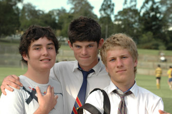 Lech (left), and Dom (right) would attend the funeral of their mate, sportsman and avid Harry Potter fan Hamish (centre), six days after the collision.