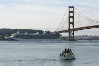 The Grand Princess passes the Golden Gate Bridge on Monday, local time.