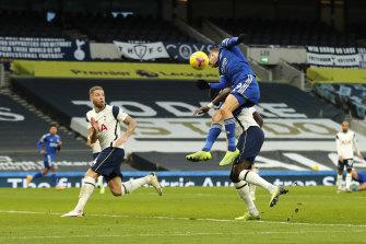 Jamie Vardy flies high for Leicester.
