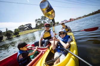 One less can in the river: The Wong family has a ball picking litter out of the Maribyrnong River.