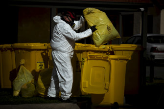Hazadous waste is removed during a deep clean of St Basil's Aged Care in Fawkner.