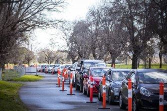 People wait to get COVID-19 tests in South Melbourne, in Victoria's fifth lockdown.