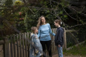 Claire Harvey, with and her two children Micha, 9, and Sarah, 12, says taking some action, any action, on climate change helps reduce her feelings of powerlessness in the face of a global crisis.