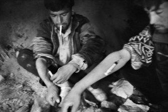 Opium addicts, Kabul, 2006.
