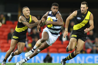 Geelong's Esava Ratugolea, who kicked two goals, breaks free of a tackle by Shai Bolton.
