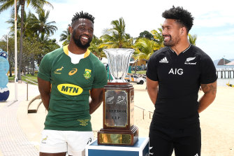 Siya Kolisi of the Springboks and Ardie Savea of the All Blacks speak as they pose with the Freedom Cup trophy.