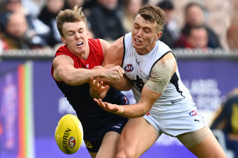 James Jordan, left, and Patrick Cripps, right, in action on Sunday.