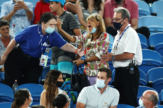 Security officials ask the spectator to leave the stadium during Nadal's match against Mmoh.