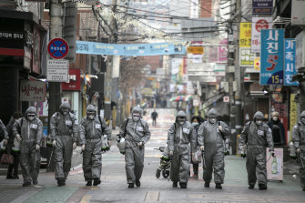 South Korean soldiers in protective gear disinfect the Eunpyeong district against the coronavirus.