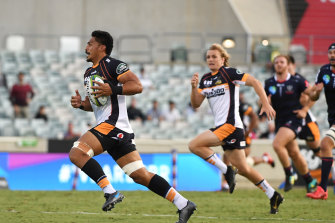Pete Samu makes a break for the try line against the Rebels in Friday's game at GIO Stadium in Canberra.