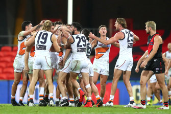 Callan Ward of the Giants is congratulated by team mates after kicking the goal that sealed the match.