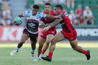 Ronaldo Mulitalo is tackled by Tyson Frizell at HBF Park on Friday.