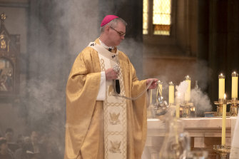 Amid a haze of incense smoke and mellowed sunlight, Archbishop Peter Comensoli's sermon mentioned Australia's firefighters.