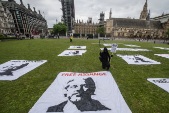 Banners are laid out as a protest picnic demanding the release of Julian Assange is held on his 50th birthday at Parliament Square in London last weekend