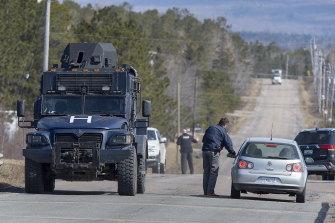 Police block the highway in Debert, Nova Scotia, during the mass shooting.
