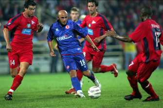 Three Xanthi FC players surround Middlesbrough's Massimo Maccarone during a UEFA Cup match in 2005.