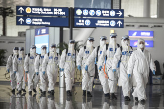 Firefighters prepare to disinfect areas at the Wuhan Tianhe International Airport in April. Wuhan  was the epicentre of the outbreak in China.