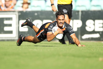 Daine Laurie's stellar trial showing for Wests Tigers might complicate the selection picture for coach Michael Maguire.