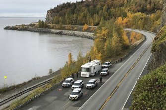Anchorage police investigate the scene where human remains were found on the Seward Highway in Alaska.