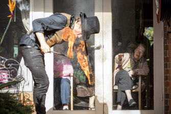 Fire performer Chris James and resident Maggie Goller during the window show at Lifeview's aged care home The Willows.